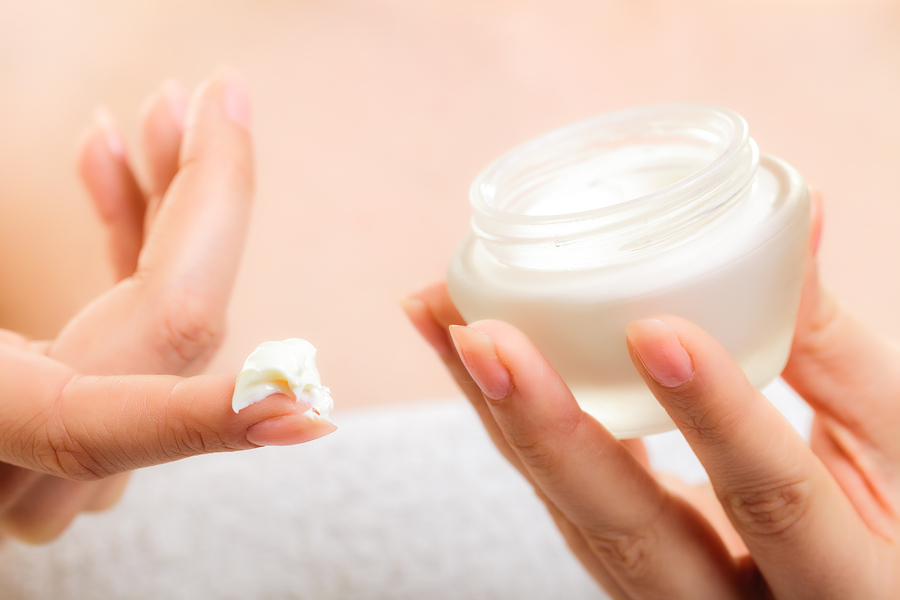 Moisturizing cream in female hands
