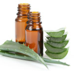 two bottles of aloe vera essential oil isolated on white
