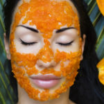 woman wearing a papaya mask